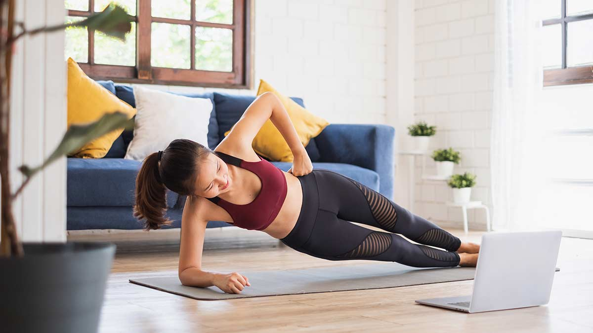 Woman Working Out at Home Virtually